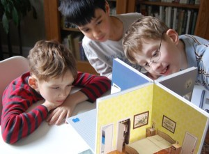 Boys and pop-up paper house
