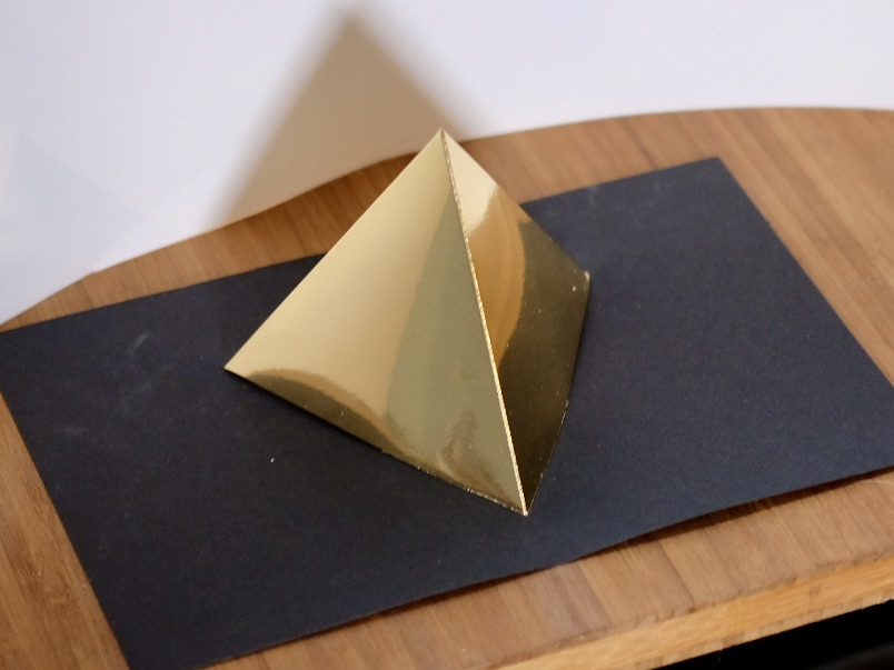 Platonic solid tetrahedron gold on black